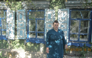 Ludmila Nikolaevna Ovchinnikova pictured with the 3 recovered windows.
