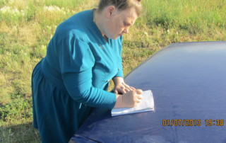Ludmila Nikolaevna Ovchinnikova writing the account of the Chelyabinsk Bolide.